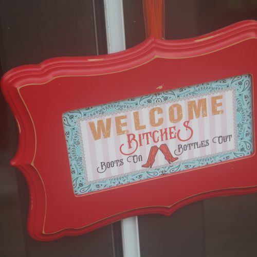 welcome bitches sign
